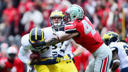 Ohio State tops Michigan to cap unbeaten season
