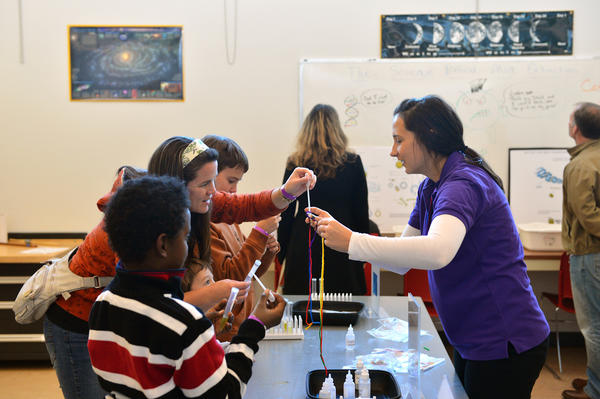 Science educator Ellen Luybli, of Hellertown (right) shows how to extract the DNA of peas at the The Da Vinci Science Center's Thanksgiving 2012: Play With Your Food Returns, it features science activities that start with food including extracting the DNA of peas, a tablecloth yank challenge, and a carrot cannon on Saturday.