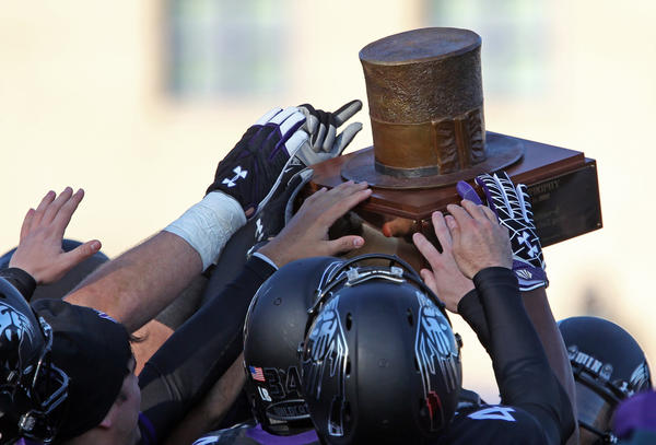 Northwestern players hoist the Land of Lincoln Trophy after beating Illinois 50-14.