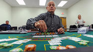 Dorsey Nicola was shaking the dice and staring down the green felt, where chips were stacked like miniature skyscrapers and multiplying. The craps table was hot last week as a half-dozen students lined the perimeter and Nicola kept throwing sixes.