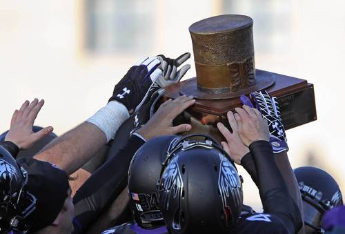 Northwestern players hoist the Land of Lincoln Trophy after beating Illinois 50-14 at Ryan Field.