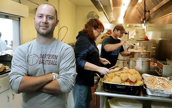Daniel Madron, a sociology professor at HCC along with his students have prepared meals at the Salvation Army before Thanksgiving.
