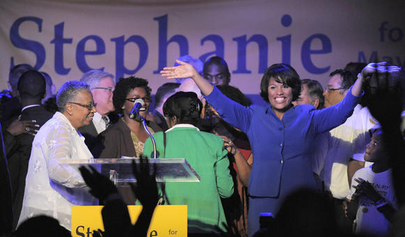 Dr. Nina Rawlings (left) smiles as she watches her daughter, incumbent mayor Steph