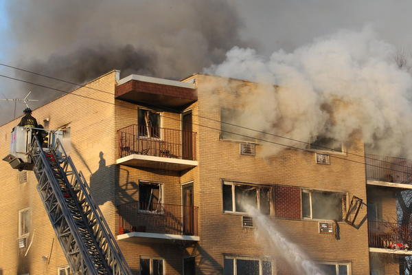 Firefighters battle an extra-alarm fire at 2030 W. 111th St. today.