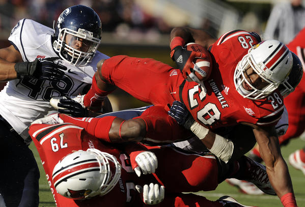 Louisville Cardinals running back Jeremy Wright didn't find much running room against the UConn defense at Papa John's Stadium in Louisville Saturday afternoon.