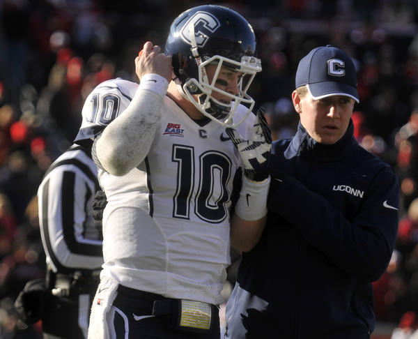 UConn QB Chandler Whitmer is helped off the field after being sacked in the fourth quarter against Louisville at Papa John's Stadium Saturday afternoon. Whitmer did not return to the game.