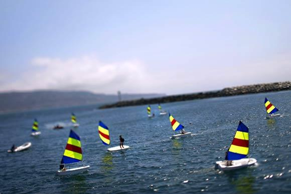 Participants in the King Harbor Youth Foundation's summer sailing program navigate through waters inside King Harbor in Redondo Beach.