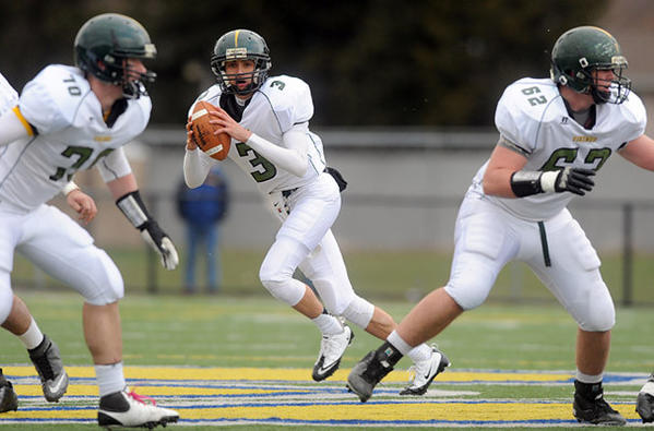 Central Catholic's QB Anthony Beck (center) looks for an open receiver during their game with Abington Heights High School during their PIAA 3A playoff game Saturday afternoon.