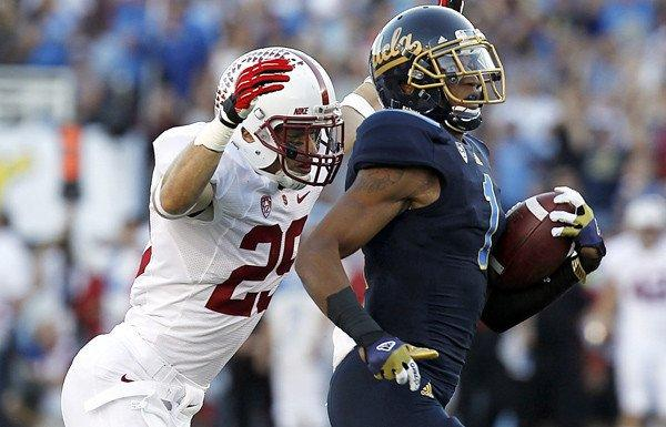 Bruins receiver Shaquelle Evans is chased down by Stanford safety Ed Reynolds after hauling in a pass for a 71-yard gain in the first quarter Saturday at the Rose Bowl.
