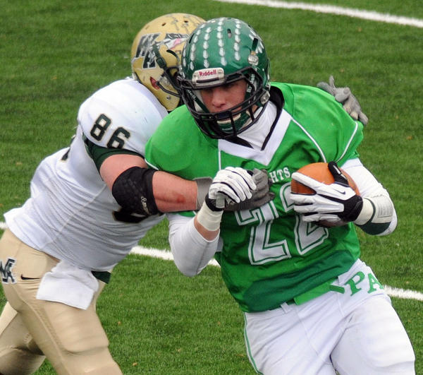 Wyoming Area High School's Trent Grove (86) gets a hold on Pen Argyl Area High School's Mike DePaolo (22) during the PIAA Class 2A first-round football game on Saturday at Northern Lehigh's Bulldog Community Stadium in Slatington.