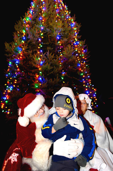 Atlee Unger, 6, right, of Hancock asked Santa for a Wii U game Saturday night during the Hancock Christmas Tree Lighting ceremony at Joseph Hancock Park on Main Street.
