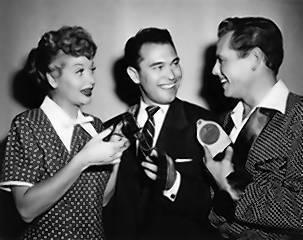"Dann Cahn, center, with Lucille Ball and Desi Arnaz, is shown after being nominated for an award from the American Cinema Editors for best editing for ""I Love Lucy"" in 1952."
