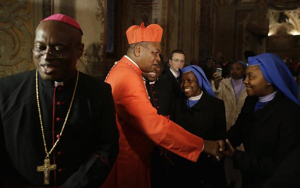 Newly installed Cardinal John Olorunfemi Onaiyekan of Nigeria (2nd L) receives guests at the Vatican November 24, 2012. Pope Benedict XVI installed six new Roman Catholic cardinals from around the world on Saturday.