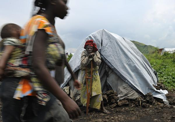A displaced elderly Congolese woman stands outside her makeshift shelter during a food aid distribution exercise conducted by humanitarian agencies at a camp for the internally displaced in Mugunga, on November 24, 2012. Thousands of people have been displace in sporadic fighting between M23 rebel outfit against government forces in easten D.R. Congo's north-Kivu region after M23 seized control of the regional capital Goma. Regional leaders called on DR Congo rebel group M23 Saturday to end hostilities and relinquish a key eastern town it seized in an advance that has sparked fears of a wider conflict. The meeting of heads of state went forward without a key player -- Rwandan President Paul Kagame, whose country the United Nations accuses of backing the rebels -- and wrapped up quickly.