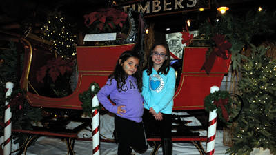 Bryn Lahew, 5, (left) and Dani Stockdale, 6, pose in front of a sleigh Seven Springs Mountain Resort. The girls are friends who traveled with parents from Waynesburg for Seven Springs Light Up Weekend. The weekend included children's activities like face painting, balloon animals and sleigh rides with Santa.