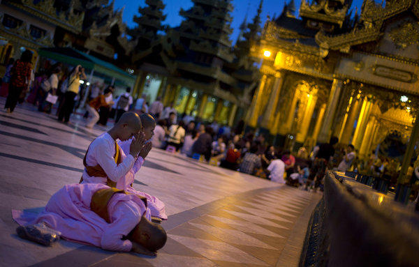 Novice Buddhist nuns perform religious rituals at Shwedagon Pagoda in Yangon, Myanmar, on Wednesday.
