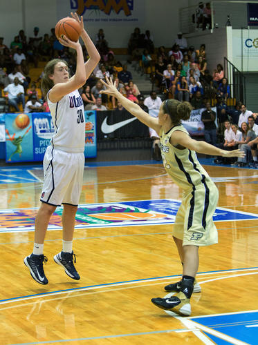 The University of Connecticut's Breanna Stewart shoots over Purdue's Sam Ostarello at the Paradise Jam Saturday night. Stewart scored 17 points.