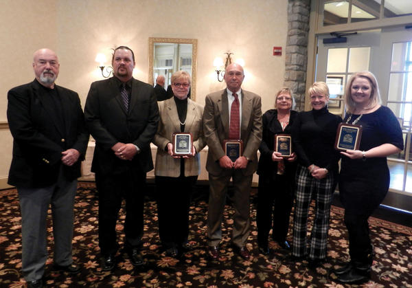 Dave Russell, Tom Walsh, Kristen Ardinger Karn and Jennifer Tsetsilas Hartmann were inducted into the St. Maria Goretti Athletic Hall of Fame on Saturday during a luncheon at Fountain Head Country Club. In the photo, from left to right, are: Bob Starkey (Dave Russell's coach at Shepherd), Mark Russell (Dave's brother), Marlene Russell (Dave's stepmother), Don Ardinger (Kristen Ardinger Karn's father), Jackie Walsh (Tom Walsh's wife), Ami Schultz (Tom Walsh's daughter) and Jennifer Tsetsilas Hartmann.