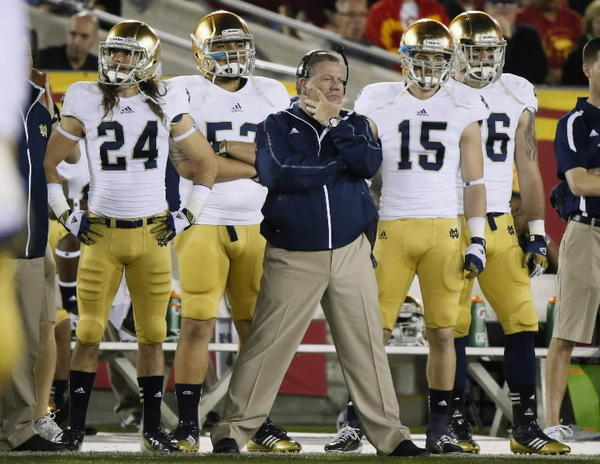 Notre Dame Fighting Irish's coach Brian Kelly (C) stands on the sideline during their win over USC Trojans during their NCAA college football game at the Coliseum in Los Angeles, California November 24, 2012. REUTERS/Lucy Nicholson