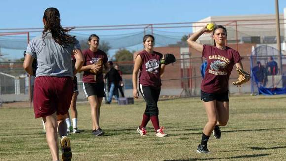 Alani Ayala, 16, practices throwing the ball.