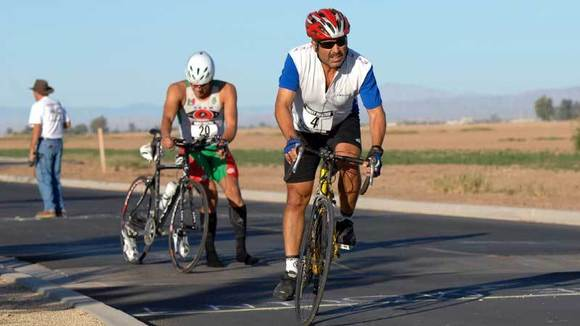 Jesus Ramirez (right) starts pedaling as Jaime Inzunza mounts his bicycle