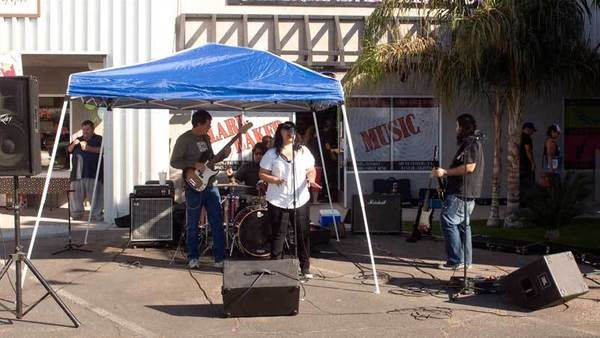Shades of Blues performs in front of Clark Baker Music in El Centro on Saturday morning.