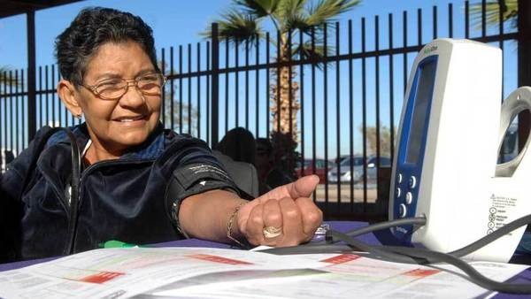 Maria Concepcion Moya, 70, gets her blood pressure checked at the El Centro Regional Medical Center booth during the health fair at Las Palmas Swap Meet in Calexico on Wednesday.