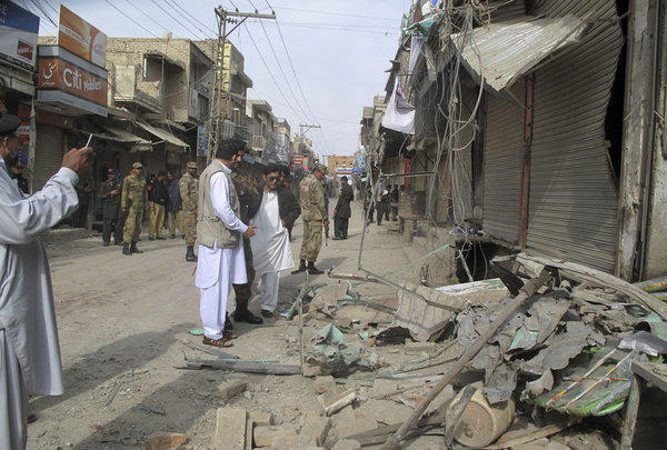 Pakistani security officials check the site of a bomb blast in Dera Ismail Khan.