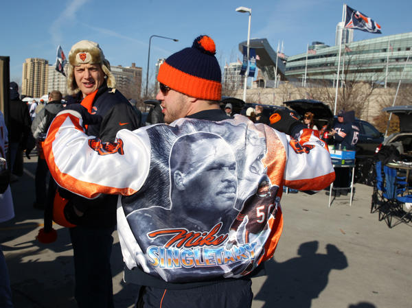 Ryan Lesak of Palos Park displays a jacket with the photo of Bears legend Mike Singletary while tailgating before the start of the Chicago Bears game against the Minnesota Vikings at Soldier Field in Chicago, on Sunday.