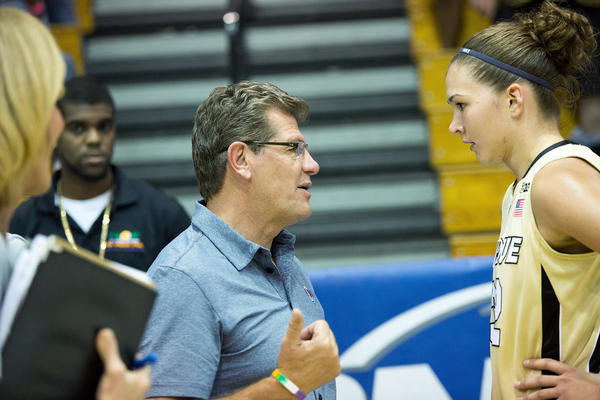 UConn coach Geno Auriemma speaks with Purdue's Sam Ostarello after the game at the Paradise Jam Saturday.