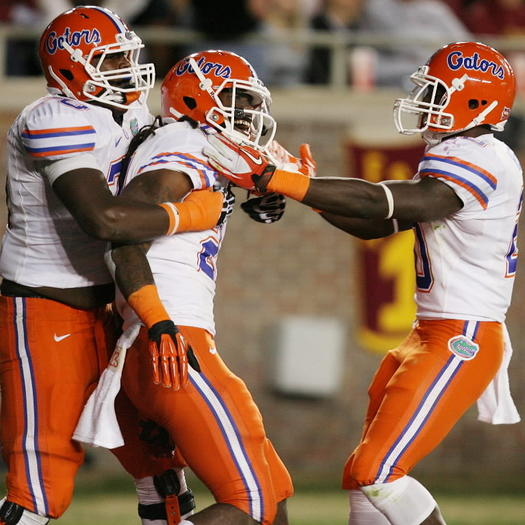 Florida's Matt Jones, middle, and his teammates celebrate during the Gators' win over rival FSU. Stephen M. Dowell, Orlando Sentinel.
