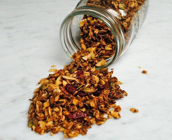 Homemade granola with chopped nuts and dried fruit.