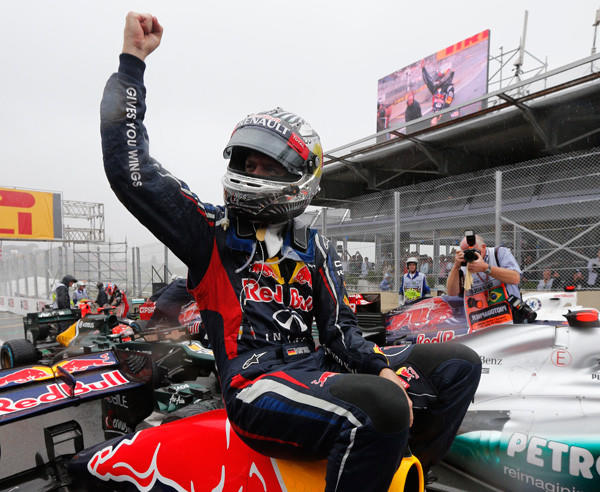 Red Bull Formula One driver Sebastian Vettel of Germany celebrates winning the world championship after finishing sixth in the Brazilian F1 Grand Prix.