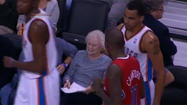 """Check out this fan sitting courtside at the Thunder game who gets hit by a pass that goes out of bounds and then gets a kiss on the head from Kevin Durant only to be nearly hit again by another tipped pass and draws the attention of Clippers guard Jamal Crawford!"""