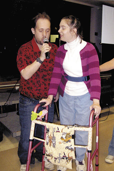 Brad Goldes and Sarah Roney sing at a recent karaoke night sponsored by Tri-State Civitan Club.t