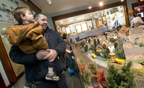 Christopher Layman of Palmer Township views a train layout with son Caiden, 2, during the Nazareth Area Society of Model Engineers Holiday Train Show in Stockertown on Sunday.