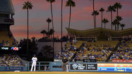 Fox Sports could pay at least $6 billion to retain the Dodgers' television rights, three parties familiar with the negotiations said Sunday.