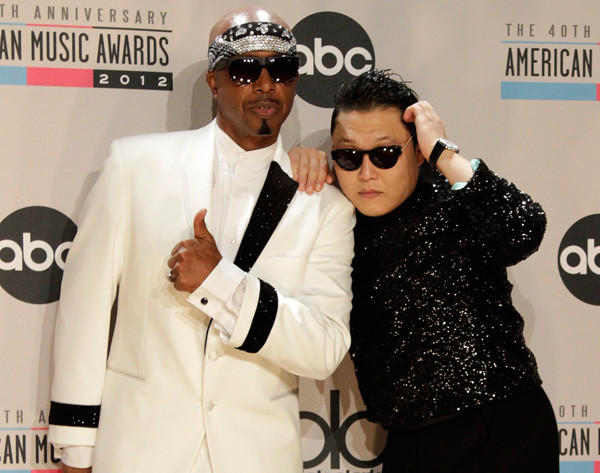 MC Hammer and Psy, right, backstage at the 40th American Music Awards in Los Angeles.