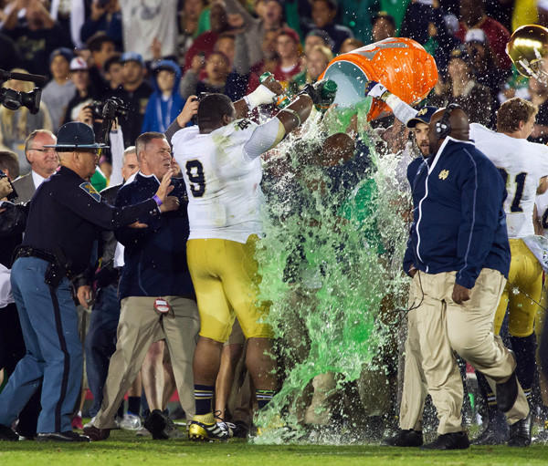 Notre Dame Fighting Irish head coach Brian Kelly hugs an assistant coach as he is showered with Gatorade after Notre Dame defeated the USC Trojans 22-13 at the Los Angeles Memorial Coliseum.
