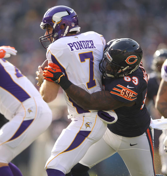 The Bears' Henry Melton sacks Vikings quarterback Christian Ponder in the first quarter.