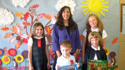 Children's author and nature photographer Kathy Miller is shown with St. Peter School students who won various contests to receive signed copies of her books. From left, front row: Ethan Rosenbaum (kindergarten), Abigail Ledney (kindergarten) and back row: Mary Bowers (4th grade), Kathy Miller, Isabelle James (6th grade).