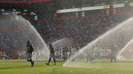 <b>Photos:</b> Sprinklers soak the Dolphins-Seahawks game