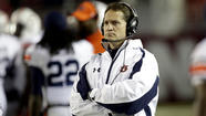 Two years after leading Auburn to the Bowl Championship Series national title, Gene Chizik has been fired as coach of the Tigers. Also losing their college football coaching jobs Sunday were Danny Hope at Purdue and Tom O'Brien at North Carolina State.