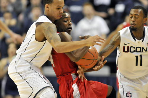 UConn guards Shabazz Napier, left, and Ryan Boatright wrap up Stony Brook's Anthony Jackson during the second half. Napier had a game high 19 points and tied with Tommy Brenton of Stony Brook with a game-high three steals. Boatright ended with nine points and one steal.
