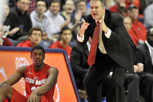 Stony Brook player Anthony Mayo waits to get into the game as coach Steve Pikiell calls for timeout after a series of three-point plays that put UConn ahead 45-39 late in the second-half. UConn defeated Sony Brook, 73-62.