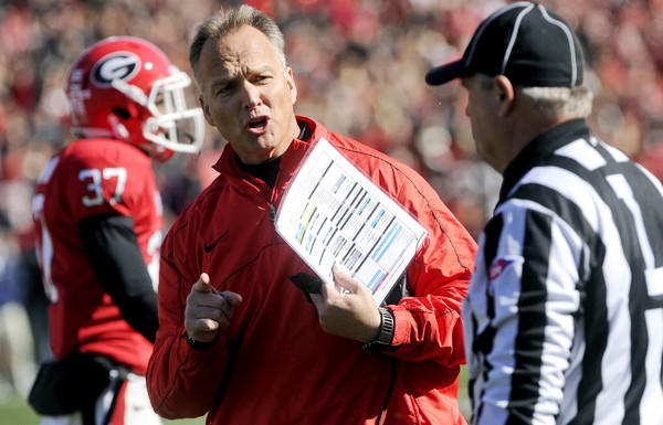 Georgia Coach Mark Richt argues a call with an official during a 42-10 victory over Georgia Tech on Saturday.