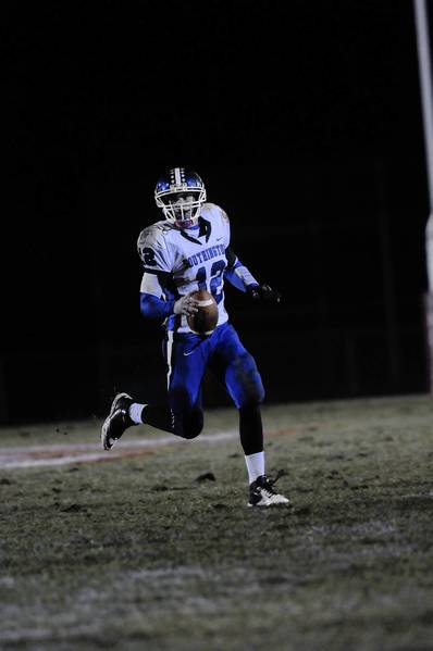 Southington quarterback Stephen Barmore runs the ball during a game against Manchester at Manchester High.