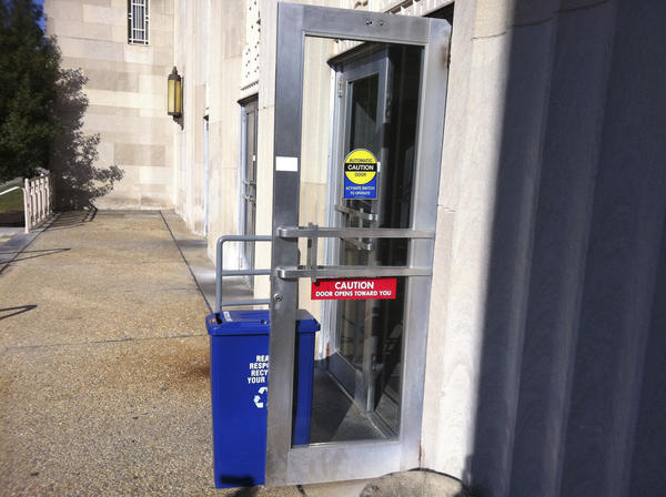 A button that helps people with disabilities open an automatic door at the Post Office on Franklin Street in Hagerstown was broken and propped open Wednesday with a plastic recycling bin.