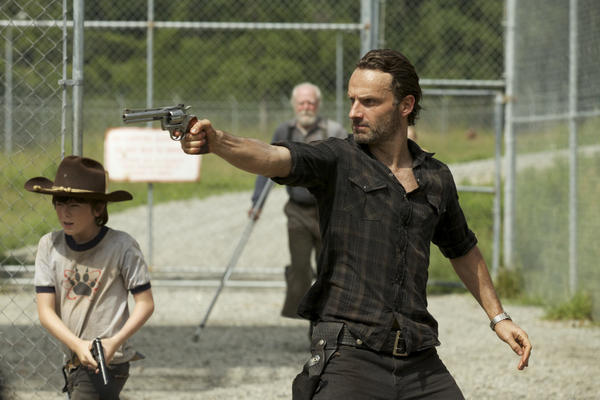 Like father, like son... Carl Grimes (Chandler Riggs) and Rick Grimes (Andrew Lincoln) - (Background) Hershel Greene (Scott Wilson)