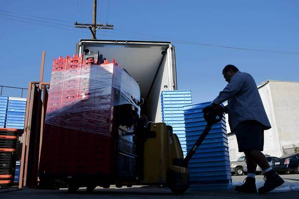 A Coca-Cola employee maneuvers a lift filled with stolen plastic pallets recovered by the Sheriff's Department. The spike in fuel prices has led to higher plastics prices and an escalation in thefts.